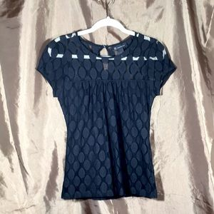 INC blouse with shear yoke and sleeves.